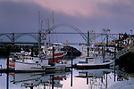 Fog at dawn over commercial fishing boats in harbor and Yaquina Bay Bridge, Yaquina Bay, Newport, Oregon Coast