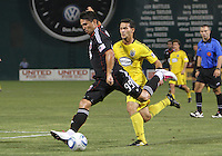 Jaime Moreno #99 of D.C. United takes a shot as Dilly Duka #11 of the Columbus Crew moves in during a US Open Cup semi final match at RFK Stadium on September 1 2010, in Washington DC. Columbus won 2-1 aet.