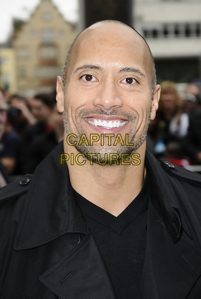 "DWAYNE ""THE ROCK"" JOHNSON.The UK film premiere of ""Race To Witch Mountain"" at Odeon Cinema West End, London, England..April 5th 2009.headshot portrait black stubble facial hair .CAP/CAN.©Can Nguyen/Capital Pictures."