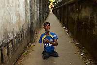 Mohammad Sharif plays with a cricket ball in an alley in Chittagong, Bangladesh.