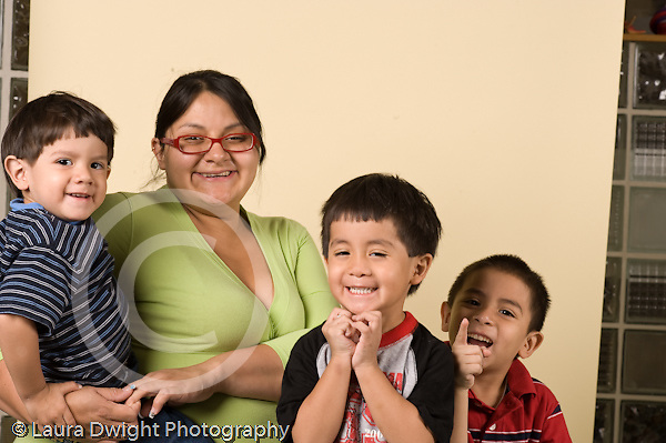pregnant mother with toddler son, and his brothers ages 3 and 4 horizontal