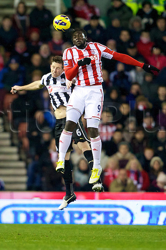 28.11.2012. Stoke, England.  Stoke City's Trinidad forward Kenwyne Jones and Newcastle United's English defender Mike Williamson in action during the Premier League game between Stoke City and Newcastle United from the Britannia Stadium, Stoke.