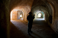A Park Ranger tells Fort Pickens' story during a tour of the passages under the structure built protect Pensacola Bay.<br /> <br /> COLIN HACKLEY PHOTO