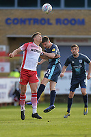 Alex Revell of Stevenage heads with Jordan Rossiter during Stevenage vs Bury, Sky Bet EFL League 2 Football at the Lamex Stadium on 9th March 2019