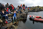 spactators (including local dog Skye who was placed in the safety boat to stop her chasing the stones) look on - at the World Stone Skimming Championships which attracted over 300 entries from all round the world - Easdale is reached by a small open ferry-boat from the Isle of Seil - south of Oban - picture by Donald MacLeod - 25.9.11 - clanmacleod@btinternet.com 07702 319 738 donald-macleod.com