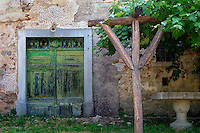 An old green door complements this Croatian arbor.