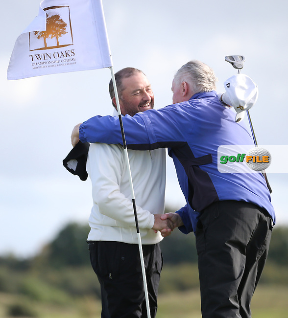 Damien McGrane (IRL) celebrates winning the final round of  The 106th Irish PGA Championship with caddie Keiran Walsh (Headfort GC President), at the Moy Valley Hotel & Golf Resort, Kildare, Ireland.  25/09/2016. Picture: David Lloyd | Golffile.