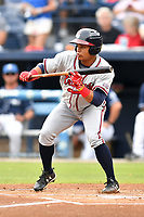 Rome Braves left fielder Randy Ventura (11) squares to bunt during a game against the Asheville Tourists at McCormick Field on July 27, 2017 in Asheville, North Carolina. The Braves defeated the Tourists 6-3. (Tony Farlow/Four Seam Images)
