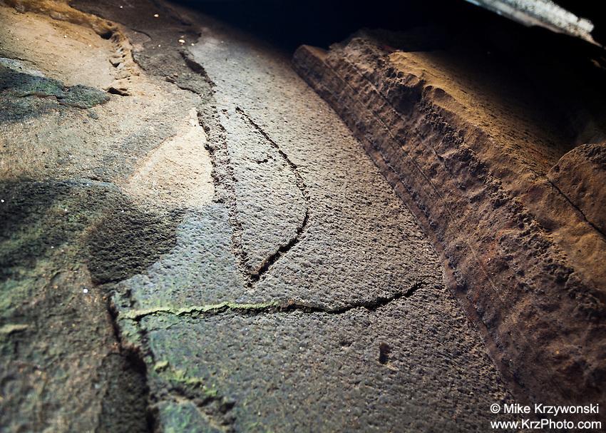 A petroglyph of a canoe with a sail, Ka'iwi Shoreline Cave Shelter, O'ahu