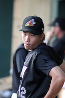 Chen-Chang Lee #12 of the Akron Aeros watches from the dugout during a game against the Harrisburg Senators at Metro Bank Park on June 10, 2011 in Harrisburg, Pennsylvania.   ..Photo By Bill Mitchell/Four Seam Images