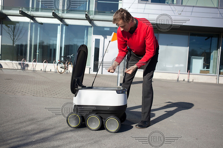 Ahti Heinla, CEO of robotic delivery company Starship, with a delivery bot.