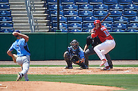 Clearwater Threshers first baseman Zach Green (12) awaits a pitch from Hunter Wood (3) while at bat in front of catcher Mac James (8) and umpire Mike Savakinas during a game against the Charlotte Stone Crabs on April 13, 2016 at Bright House Field in Clearwater, Florida.  Charlotte defeated Clearwater 1-0.  (Mike Janes/Four Seam Images)