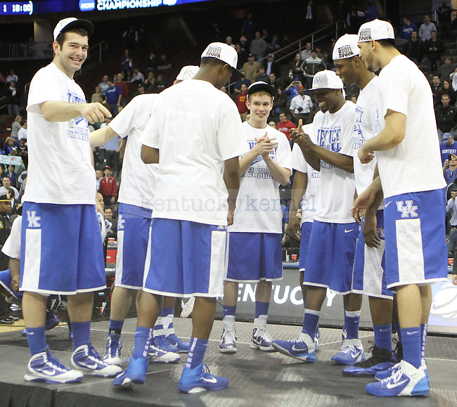 The University of Kentucky basketball team celebrates together after defeating UNC in the Elite 8 game of the 2011 NCAA Basketball Tournament, at the Prudential Center, in Newark, NJ.  Photo by Latara Appleby | Staff