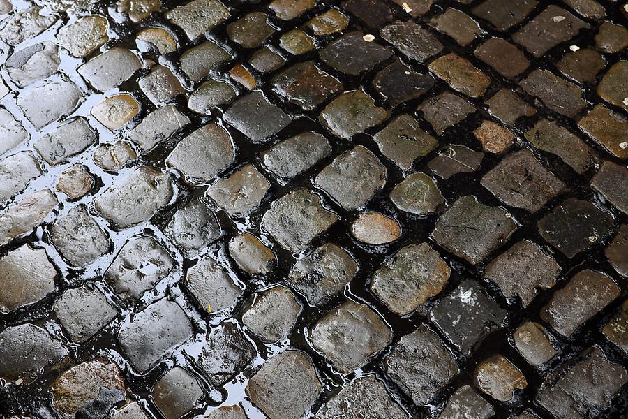 Wet cobblestone street, Old Town Lucerne, Switzerland, Europe
