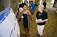 Kenya Johnson, a senior studying biological sciences at Jackson State University, explains her research project to Mississippi State University Provost and Executive Vice President Judy Bonner during MSU's summer Undergraduate Research Symposium. Johnson is collaborating with MSU Department of Biological Sciences faculty member Donna Gordon through the Mississippi IDeA Network of Biomedical Research Excellence, a partnership between state universities designed to build a biomedical research infrastructure in Mississippi. (photo by Russ Houston / © Mississippi State University)