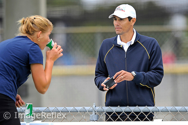 12 February 2011:  FIU Assistant Coach Dimitrio Martinez speaks with Rita Maisak in between games as the FIU Golden Panthers defeated the Arkansas State University Red Wolves, 7-0, at University Park in Miami, Florida.