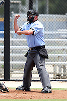 Home plate umpire Drew Maher makes a call during a game between the GCL Blue Jays and GCL Tigers at the Englebert Complex on June 24, 2011 in Dunedin, Florida.  The Tigers defeated the Blue Jays 8-4.  (Mike Janes/Four Seam Images)
