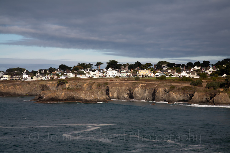 View of Mendocino Village across Mendocino Bay on the coast of Northern California.