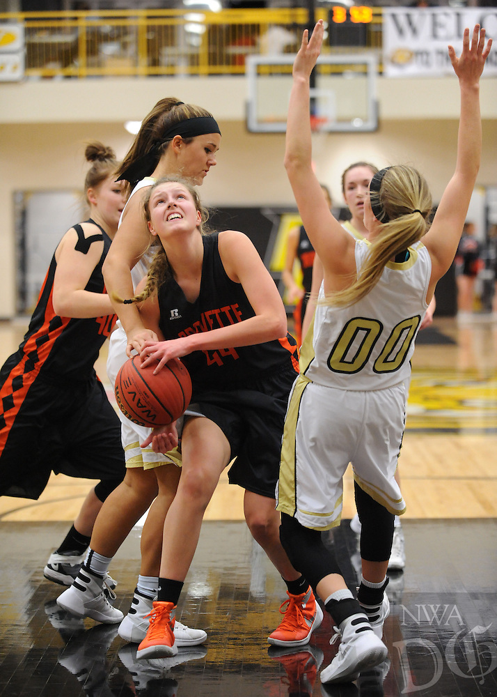 NWA Democrat-Gazette/ANDY SHUPE<br /> Sydney Hicks (center) of Gravette attempts a shot in the lane as she is fouled by Carlee McClure (left) of Pottsville as Aspen Campbell (00) attempts to draw the charge Wednesday, Feb. 24, 2016, during the first half of play in the 4A North Regional Tournament in Tiger Arena in Prairie Grove. Visit nwadg.com/photos to see more photographs from the game.