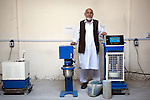 2 June 2013,  Jalalabad, Afghanistan.   Arifullah Mandozai, Dean of Engineering at Nangarhar University in Jalalabad shows off some engineering equipment that has broken down since purchase and neglected to be repaired due to lack of technical support.  Many of the facilities and equipment at the University are being provided under the World Bank funded Strengthening Higher Education Program ( SHEP). The objective of the program is to restore basic operational performance at a group of core universities in Afghanistan. It aims to act as a catalyst to attract resources at Afghan tertiary education in the long term.  SHEP is the first major education investment in Afghanistan by the World Bank. In 2008 it received $US 5 million from ARTF to expand infrastructure and equipment to Universities in Kabul, Nangarhar , Balkh and Kandahar.  Picture by Graham Crouch/World Bank