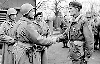 BNPS.co.uk (01202 558833)<br /> JonDiamond/BNPS<br /> <br /> Major-General Matthew Ridgway (left), the XVIII Airborne Coprs commander and Montgomery decorate Brigadier James Hill. <br /> <br /> Remarkable rarely seen photos of heroic Allied soldiers fighting their way across Europe before crossing the River Rhine 75 years ago feature in a new book.<br /> <br /> They are published in Images of War, Montgomery's Rhine Crossing, which tells the story of the legendary offensive, nicknamed Operation Plunder, in March 1945.<br /> <br /> On the night of March 23, Field Marshal Bernard Montgomery's 21st Army Group launched a massive artillery, amphibious and airborne assault to breach the historic defensive water barrier protecting northern Germany.<br /> <br /> At the same time, the Americans, with the support of the British 6th Airborne Division, set in motion Operation Varsity - involving 16,000 paratroopers - on the east bank of the Rhine. They were dropped here to seize bridges to prevent German reinforcements from contesting the bridgeheads.<br /> <br /> Fierce fighting ensued, with much bloodshed on both sides as the Allies met determined resistance from machine gun nests. But the daring operation proved successful, helping to considerably shorten the war - the Nazis surrendered just six weeks later.
