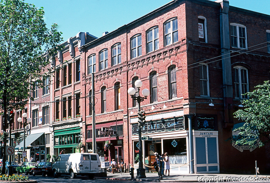 Seattle: SW Corner, 1st & Washington, 1 block south of Pioneer Square. None of these buildings is listed. Photo '86.