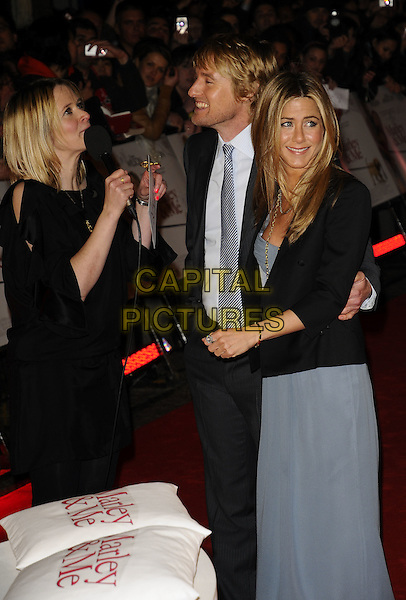 "EDITH BOWMAN, OWEN WILSON & JENNIFER ANISTON.""Marley & Me"" UK film premiere held at Vue cinema, Leicester Square, London, England. .March 2nd, 2009.half length blue dress strapless gold necklaces chains Burberry silk beige grey gray suit tie georgette blazer profile interview microphone laughing funny face .CAP/CAN.©Can Nguyen/Capital Pictures."