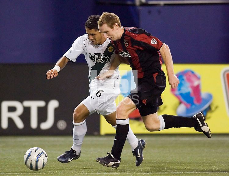 The Galaxy's Herculez Gomez and Tim Regan of the MetroStars race towards the corner. The MetroStars defeated the Los Angeles Galaxy 2 - 1 at Giant's Stadium, East Rutherford, NJ, on July 9, 2005.