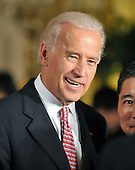 Washington, D.C. - May 1, 2009 -- United States Vice President Joseph Biden attend the ceremonial swearing-in of Commerce Secretary Gary Locke and Health and Human Services Secretary Kathleen Sebelius in the East Room of the White House in Washington, D.C. on Friday, May 1, 2009. <br /> Credit: Ron Sachs / CNP