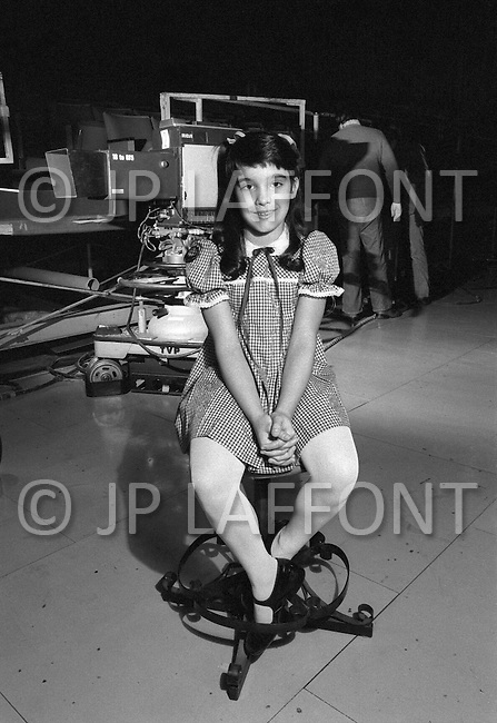 California - Child actress Danielle Brisebois on set of a television studio - Child labor as seen around the world between 1979 and 1980 – Photographer Jean Pierre Laffont, touched by the suffering of child workers, chronicled their plight in 12 countries over the course of one year.  Laffont was awarded The World Press Award and Madeline Ross Award among many others for his work.