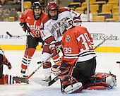 Jon Pelle (Harvard - 11), Brad Thiessen (NU - 39) - The Northeastern University Huskies defeated the Harvard University Crimson 3-1 in the Beanpot consolation game on Monday, February 12, 2007, at TD Banknorth Garden in Boston, Massachusetts.