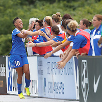 Boston Breakers forward Lianne Sanderson (10) celebrates her goal with teammates.  In a National Women's Soccer League (NWSL) match, Portland Thorns FC (white) defeated Boston Breakers (blue), 2-1, at Dilboy Stadium on July 21, 2013.