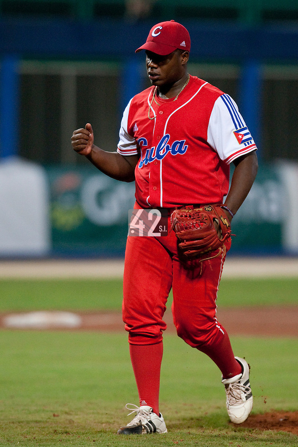 24 September 2009: Yadier Pedroso of Cuba reacts as he pitches against Team USA during the 2009 Baseball World Cup final round match won 5-3 by Team USA over Cuba, in Nettuno, Italy.