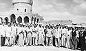 Iraq 1952 .In front the mosque of Kader Karam, district of Kirkuk, in the middle Sheikh Mohamed Kader Karam with Iraqi and Kurdish officials celebrating Mouloud, with sunglasses Sheikh Marouf Barzinji and extreme left Sheikh Hussein Barzinji.Irak 1952.Groupe devant la mosquee de Kader Karam, province de Kirkouk, au centre Sheikh Mohamed Kader Karam avec des officiels kurdes et irakiens le jour de moloud et avec lunettes de soleil, Sheikh Marouf Barzinji et a l'extreme gauche,sheikh Hussein Barzinji