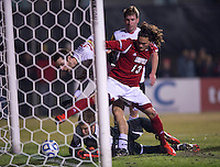 Patrick Mullins (15) of Maryland watches his shot go over the line for a goal as neither Brock Granger (13) or Zach Torp (1) of Louisville can reach it during the game at Ludwig Field in College Park, MD.  Maryland defeated Louisville, 3-1.