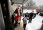 CHESHIRE, CT - 30 DECEMBER 2017 - 123017JW08.jpg -- Santa gets a hug from Becket Maher as his mother Tracey Maher and brothers Shepard Maher and Alden Maher watch as Cheshire Police Officer Jay Bodell and other members of police, fire and Campion Ambulance bring the first of the gifts to replace the ones that were stolen. The gifts were in the family car that was stolen from a family members home in Waterbury on Christmas Day. Jonathan Wilcox Republican-American