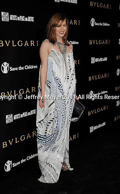 LOS ANGELES, CA - January 13: Milla Jovovich attends Save The Children's U.S. Programs And Artists For Peace And Justice Hosted By Bulgari at Ron Burkle's Green Acres Estate on January 13, 2011 in Beverly Hills, California.