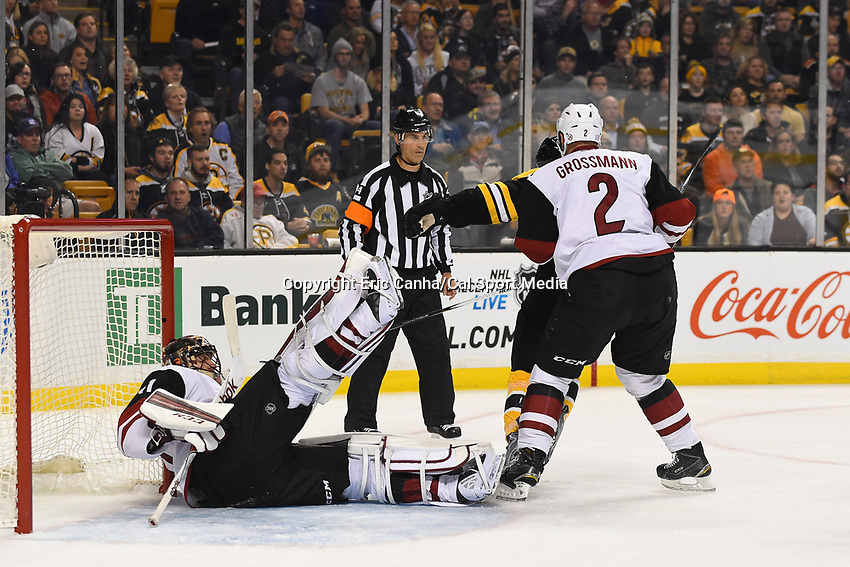 Tuesday, October 27, 2015: Arizona Coyotes goalie Mike Smith (41) falls back after colliding with Boston Bruins left wing Loui Eriksson (21) during the National Hockey League game between the Arizona Coyotes and the Boston Bruins held at TD Garden, in Boston, Massachusetts. The Coyotes lose to the Bruins 6-0 in regulation time. Eric Canha/CSM