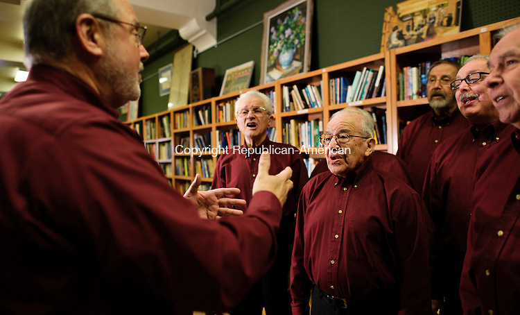 WATERBURY, CT - 14 March 2013-031413EC03--    Gabe Riccio (L) leads members of the Waterbury/Derby Valley Chordsmen in song at John Bale Book Company in Waterbury.  In the center is the group's oldest member, Tony Grosso of Waterbury, who has been singing in the group for 66 years.  The men's barbershop chorus has been active since 1947, singing both contemporary hits and classics.  Erin Covey Republican-American.