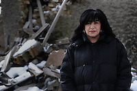 Terremoto del L'Aquila un' anno dopo. Earthquake L'Aquila one year after.Miranda Perilli fiorista, davanti le macerie della sua casa..Miranda Perilli florist in front of the rubble of her house...