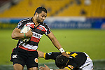 Lelia Masaga tries to fend off Shannon Paku as he races down the sideline. Air New Zealand Cup rugby game between Counties Manukau Steelers & Wellington played at Mt Smart Stadium on the 31st August 2007. The Score was 13 all at halftime, with Wellington going on to win 33 - 18.