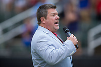 Pastor Greg Sloop of the Kannapolis Church of God sings the National Anthem prior to the South Atlantic League game between the Delmarva Shorebirds and the Kannapolis Intimidators at Kannapolis Intimidators Stadium on July 3, 2017 in Kannapolis, North Carolina.  The Shorebirds defeated the Intimidators 5-2.  (Brian Westerholt/Four Seam Images)