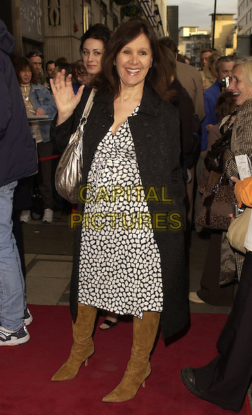 "ARLENE PHILLIPS.Outside arrivals for ""Movin' Out"" Opening Night, .Apollo Victoria Theatre, London, England, .April 10th 2006..full length black and white print dress waving hand.Ref: CAN.www.capitalpictures.com.sales@capitalpictures.com.©Can Nguyen/Capital Pictures"