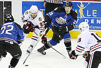 San Antonio Rampage's James Wright (28) and Scott Timmins (32) fight for the puck against Rockford Icehogs' Brandon Pirri (27) and Jeremy Morin (19) during the first period of an AHL hockey game, Saturday, Jan. 14, 2012, in San Antonio. (Darren Abate/pressphotointl.com)