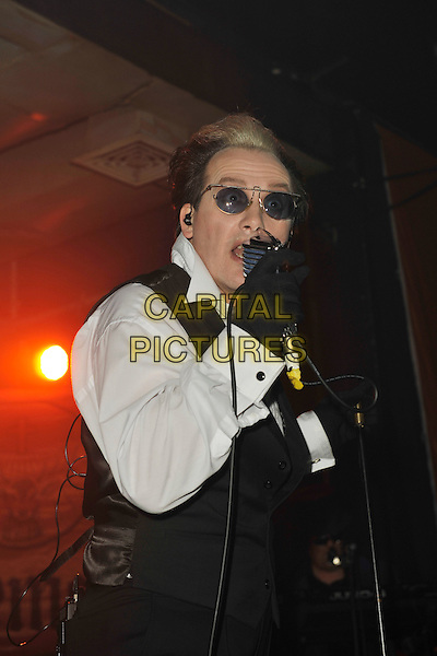THE DAMNED - David Vanian (born David Lett).The Damned performing live at The Scala as part of the Bizarre Winter Ball, London, England..November 20th, 2010.stage concert live gig performance music half length black waistcoat white shirt scarf sunglasses shades gloves singing .CAP/MAR.© Martin Harris/Capital Pictures.