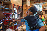 NWA Democrat-Gazette/ANTHONY REYES &bull; @NWATONYR<br /> Michael Henderson shows his son Jesse Henderson, 4, both of Centerton, machines Monday, Sept. 7, 2015 at the War Eagle Mill in Rogers. The Mill was celebrating Labor Day with jewelry demonstrations with artist Janet Alexander of Eureka Springs and live country music from Ronny Gibbons of Rogers. Many family came to see the mill and enjoy Labor Day.