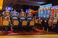 Las Vegas, Nevada.  The Linq Casino.  People Playing Slot Machines.