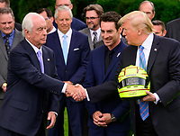 United States President Donald J. Trump, right, shakes hands with Roger Penske, left as winning driver Simon Pagenaud, center, looks on as the President greets the 103rd Indianapolis 500 Champions: Team Penske, on the South Lawn of the White House in Washington, DC on Monday, June 10, 2019.  The President took some questions on trade, Mexico, and tariffs against China.<br /> Credit: Ron Sachs / CNP/AdMedia
