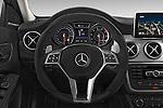 Car pictures of steering wheel view of a 2015 Mercedes Benz GLA-KLASSE AMG 5 Door SUV Steering Wheel