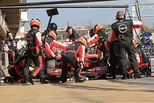 21.02.2012 Barcelona Spain. Formula One testing, day 1. Marussia pit team doing pit stops with Charles Pic.
